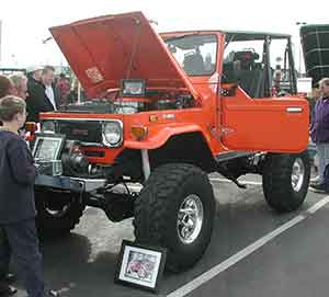 Orange Toyota LandCruiser at a previous Convention vehicle show
