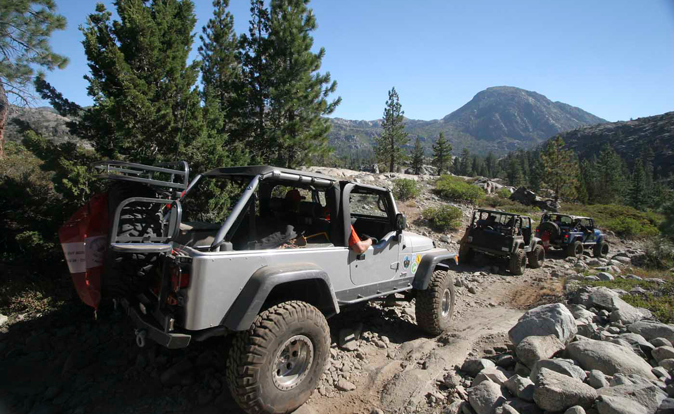 Vehicles on trail at Sierra Trek. Photo by Chris Collard.