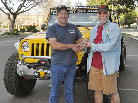Craig Felix (left) picks up the keys from Steve Gardiner