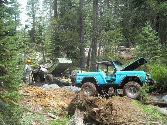 Volunteers from the Hi-Landers 4WD Club transported gravel to the Barrett 4WD Trail project site this summer for construction of rolling dips.