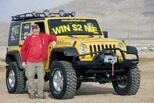 John Bachelder poses with his new Jeep