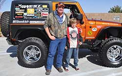 Lance Coffman and his son pose with their new Jeep
