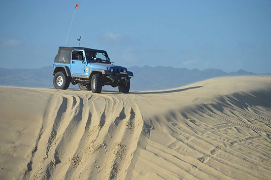 Jeep on the dunes at Oceano SVRA by High Desert Four Wheelers